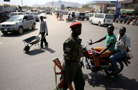 FILE PHOTO: A Sudan People's Liberation Army (SPLA) soldier walks along a street in Juba, South Sudan December 21, 2013. REUTERS/Goran Tomasevic/File Photo
