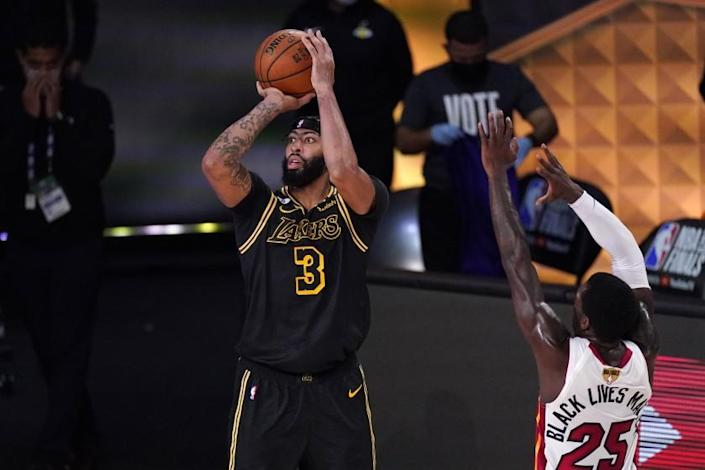 Los Angeles Lakers' Anthony Davis (3) takes a shot as Miami Heat's Kendrick Nunn (25) defends during the first half of Game 2 of basketball's NBA Finals, Friday, Oct. 2, 2020, in Lake Buena Vista, Fla. (AP Photo/Mark J. Terrill)