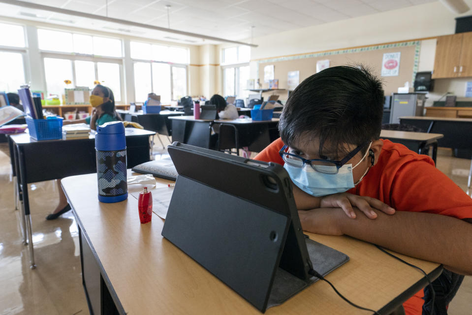 A student works at his desk at the Post Road Elementary School during the coronavirus outbreak, Thursday, Oct. 1, 2020, in White Plains, N.Y. (AP Photo/Mary Altaffer)
