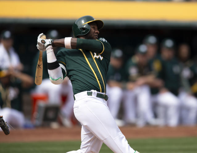 Oakland Athletics' Jurickson Profar watches his solo home run against the San Francisco Giants during the fourth inning of an exhibition baseball game Sunday, March 24, 2019, in Oakland, Calif. (AP Photo/D. Ross Cameron)