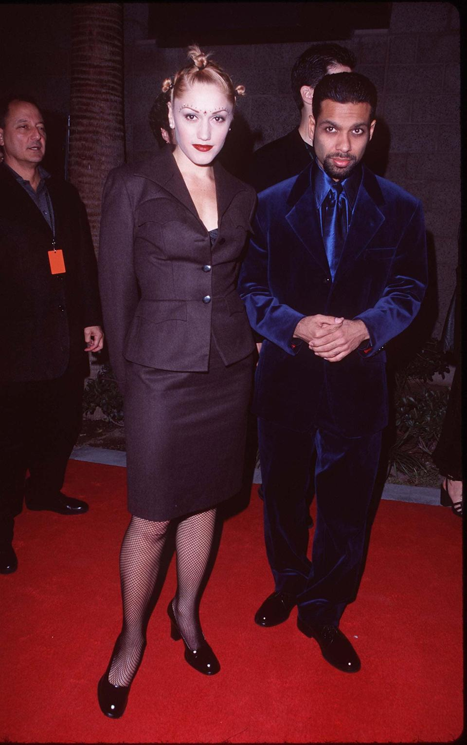 """<p>Stefani's first major public relationship was with Kanal, her bandmate from No Doubt. They dated from 1987 until 1994, at which point Kanal ended the relationship - <a href=""""https://web.archive.org/web/20060614111431/http://www.msnbc.msn.com/id/5783821/site/newsweek/"""" class=""""link rapid-noclick-resp"""" rel=""""nofollow noopener"""" target=""""_blank"""" data-ylk=""""slk:which nearly ended the band, too"""">which nearly ended the band, too</a>, according to a 2004 <strong>Newsweek</strong> article. """"I was completely passive, no goals. I was in love with Tony and just happy to be in the band. Then there was three years writing in our garage until [the 1995 album] <strong>Tragic Kingdom</strong> came out,"""" Stefani told the magazine.</p> <p>During their relationship, Stefani told <strong>The Guardian</strong>, she was less concerned with her career in music and more about the future of their romance. """"<a href=""""http://www.theguardian.com/music/2005/jan/30/popandrock.gwenstefani"""" class=""""link rapid-noclick-resp"""" rel=""""nofollow noopener"""" target=""""_blank"""" data-ylk=""""slk:All I ever did was look at Tony"""">All I ever did was look at Tony</a> and pray that God would let me have a baby with him."""" The band did survive their breakup, and they continued performing together until the band went on hiatus in 2015.</p>"""