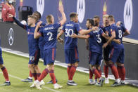The Chicago Fire celebrate a goal by midfielder Luka Stojanovic (8) against the New England Revolution during the first half of an MLS soccer match in Chicago, Saturday, April 17, 2021. (AP Photo/Mark Black)