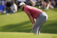Jon Rahm reacts after missing a putt on the 14th hole during the final round of play in the Tour Championship golf tournament at East Lake Golf Club, Sunday, Sept. 5, 2021, in Atlanta. Rahm finished in second place behind Patrick Cantlay. (AP Photo/Brynn Anderson)