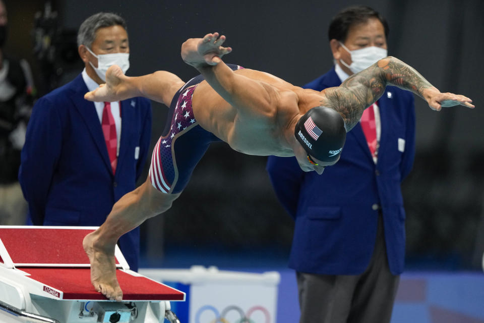 Caeleb Dressel, of United States, starts the men's 100-meter butterfly final at the 2020 Summer Olympics, Saturday, July 31, 2021, in Tokyo, Japan. (AP Photo/Jae C. Hong)
