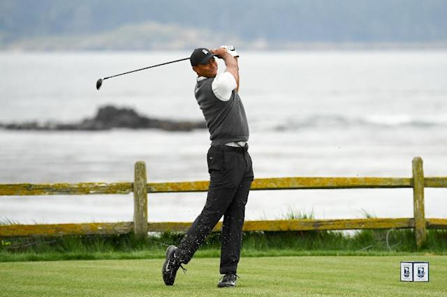 Tiger Woods tees off at 18 on the way to a first-round 70 in the 2019 US Open at Pebble Beach (AFP Photo/ROSS KINNAIRD)