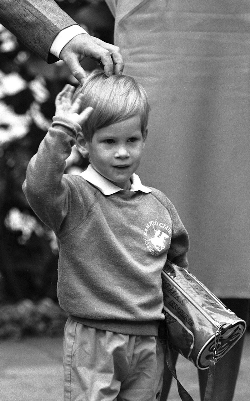 A 3-year-old Duke of Sussex, then Prince Harry, waves hello on his first day of nursery school at Chepstow Villas in west London, carrying his Thomas the Tank Engine bag. The Duke of Sussex has recorded an on-camera introduction to the new animated special