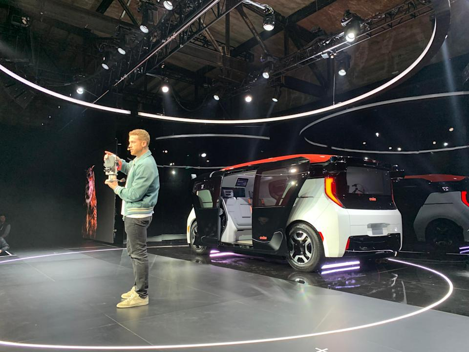 Kyle Vogt, co-founder and CTO of Cruise, GM's self-driving car division, shows off some sensor technology at the unveiling of the company's first purpose built self-driving, ride-hailing electric car, the box-like Origin.
