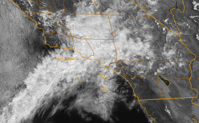 This satellite image provided by NOAA shows the California coastline with a plume of moisture from former Tropical Storm John bringing showers to Southern California on Wednesday, Sept. 5, 2012, including the area where a wildfire has been burning in the San Gabriel Mountains since the weekend. More than 1,200 firefighters were working to increase containment of the blaze northeast of Los Angeles. The National Weather Service said the chance of showers and thunderstorms would last through Thursday. (AP Photo/NOAA)