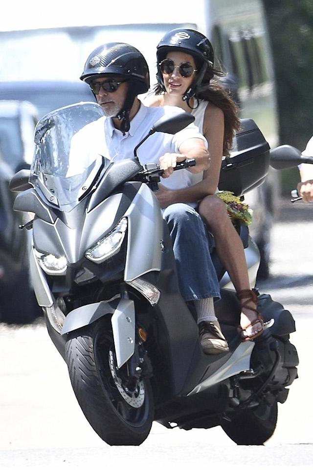 Clooney takes his wife, Amal, for a ride in Italy. (Photo: Backgrid)