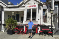 Johnny Metheny stands outside Solstice, a restaurant that he closed last year because pandemic dining restrictions made it too difficult to stay in business,in San Francisco on Feb. 13, 2021. Metheny owns three other restaurants in the city, and two are temporarily closed. The pandemic has forced thousands of restaurants to permanently shut their doors as dining restrictions keep customers away. But the unprecedented closures have created a business boom for commercial auctioneers that buy and sell used restaurant equipment. (AP Photo/Terry Chea)