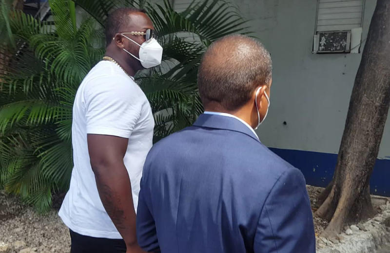 Minnesota Twins slugger Miguel Sano, right, arrives to the Prosecutor's Office accompanied by his lawyer, in his hometown San Pedro de Macoris, Dominican Republic, Thursday, June 25, 2020. Authorities in the Dominican Republic have opened an investigation into allegations the first baseman participated in the kidnapping and beating of a man in his homeland. Sano, who signed a three-year, $30 million contract with the Twins in January, denies the allegation and has said he's being blackmailed. (AP Photo/Martin Adames)
