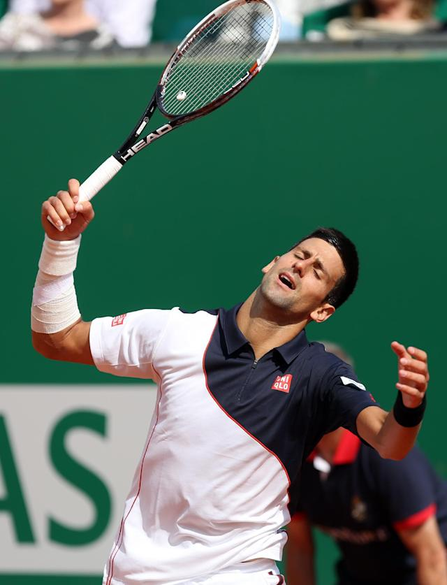 Novak Djokovic of Serbia reacts after losing a point against Roger Federer of Switzerland, during their semifinal match of the Monte Carlo Tennis Masters tournament, in Monaco, Saturday, April, 19, 2014. Federer won 7-6, 6-2. (AP Photo/Claude Paris)