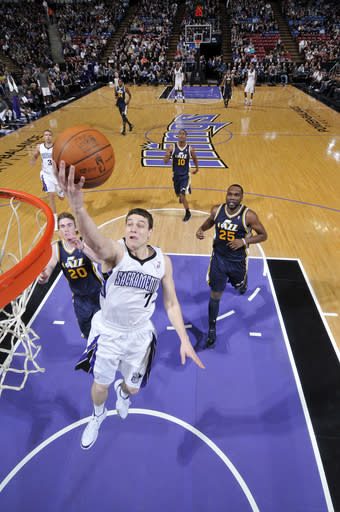 SACRAMENTO, CA - FEBRUARY 28: Jimmer Fredette #7 of the Sacramento Kings takes the ball to the basket against the Utah Jazz on February 28, 2012 at Power Balance Pavilion in Sacramento, California. (Photo by Rocky Widner/NBAE via Getty Images)