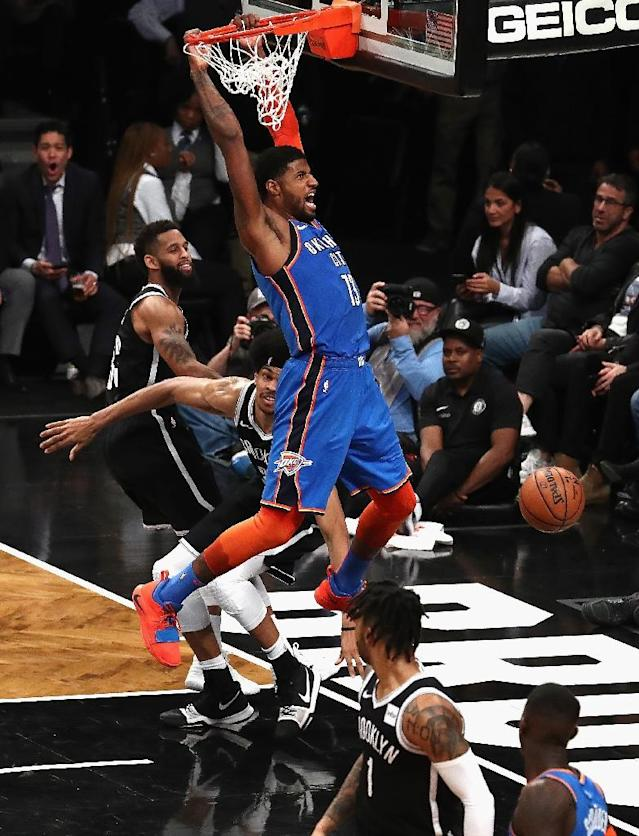 Oklahoma City's Paul George celebrates a dunk in the Thunder's 114-112 NBA victory over the Brooklyn Nets (AFP Photo/AL BELLO)