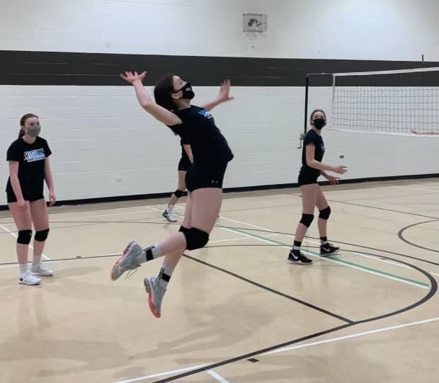 Players on the U15 Blue team of the Vision Elite Volleyball Club during a practice.
