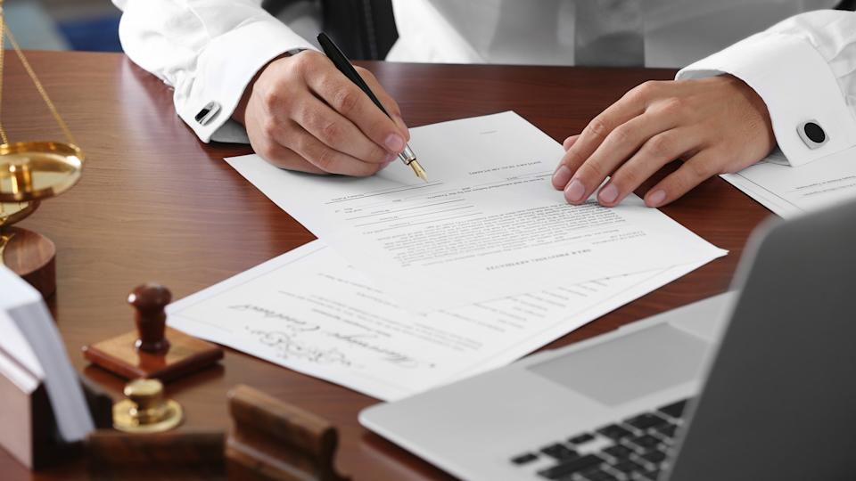 96 Money-Making Skills You Can Learn in Less Than a Year, Notary public in office signing document