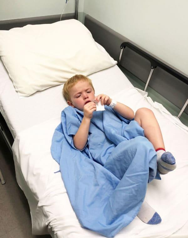 My Son Has Eosinophilic Esophagitis: little boy laying in bed