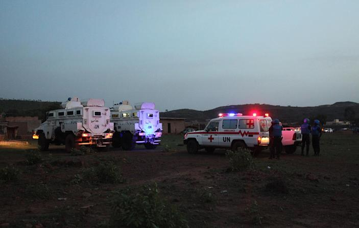 <p>United Nations armored personnel vehicles are stationed with an ambulance outside Campement Kangaba, a tourist resort near Bamako, Mali, Sunday, June 18, 2017. (Baba Ahmed/AP) </p>