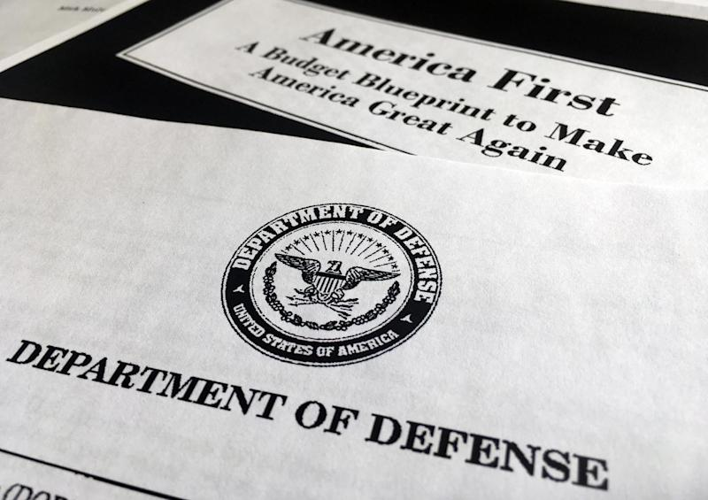 A portion of President Donald Trump's first proposed budget, focusing on the Department of Defense, and released by the Office of Management and Budget, is photographed in Washington, Wednesday, March 15, 2017. President Donald Trump is unveiling a $1.15 trillion budget, a far-reaching overhaul of federal government spending that slashes a dozen departments to finance a significant increase in the military and make a down payment on a U.S.-Mexico border wall. (AP Photo/Jon Elswick)