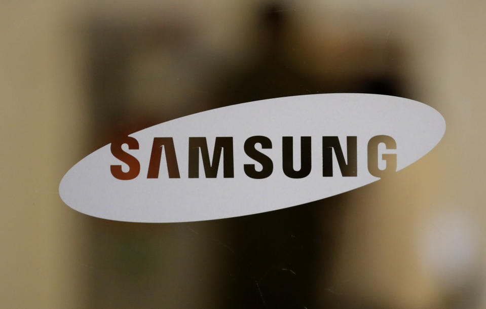 A logo of Samsung Electronics is seen at its Seocho building in Seoul, South Korea, Sunday, Oct. 25, 2020. As Samsung Electronics mourns the death of its long-time chairman, Lee Kun-Hee, questions loom over what's next for South Korea's biggest company. Samsung has struggled for years to diversify from its core hardware business to tap new technologies and services.(AP Photo/Lee Jin-man)