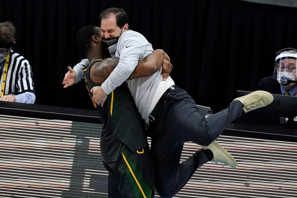 Baylor head coach Scott Drew gets a hug from guard Mark Vital at the end of the championship game against Gonzaga.