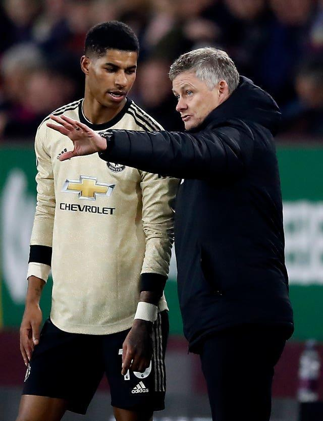 Solskjaer (right) says Rashford has his full support after recently being subjected to racial abuse