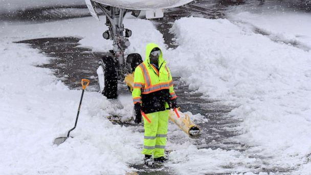 PHOTO:Ground crews remove snow from the airport tarmac as flights resume after an overnight snowfall, at the Albany International Airport in Colonie, N.Y., Dec. 2, 2019. (Hans Pennink/AP)