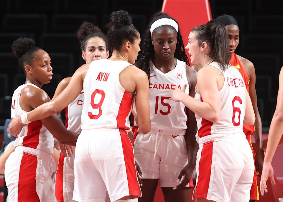 SAITAMA, JAPAN - AUGUST 01: Members of Team Canada huddle during the second half of a Women's Basketball Preliminary Round Group A game against Spain at Saitama Super Arena on August 01, 2021 in Saitama, Japan. (Photo by Gregory Shamus/Getty Images)