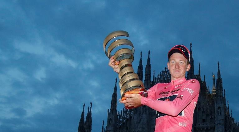 Pretty in pink: Tao Geoghegan Hart, who only pulled on the leader's jersey after the last stage, shows off his Giro d'Italia trophy