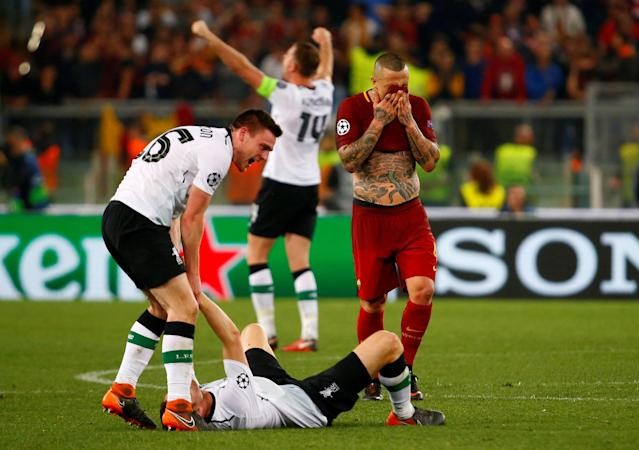 Soccer Football - Champions League Semi Final Second Leg - AS Roma v Liverpool - Stadio Olimpico, Rome, Italy - May 2, 2018 Roma's Radja Nainggolan looks dejected after the match as Liverpool's Andrew Robertson and team mates celebrate after the match REUTERS/Tony Gentile TPX IMAGES OF THE DAY