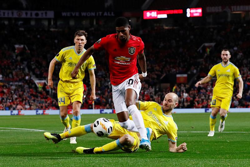Soccer Football - Europa League - Group L - Manchester United v Astana - Old Trafford, Manchester, Britain - September 19, 2019 Manchester United's Marcus Rashford in action with Astana's Ivan Maevski Action Images via Reuters/Jason Cairnduff
