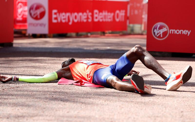 Mo Farah lies on the floor at the finish with exhaustion - REUTERS