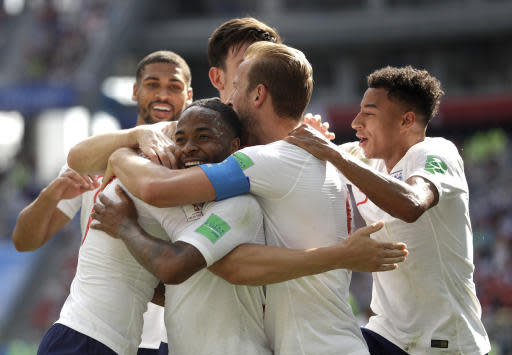 England's John Stones is congratulated by teammates after scoring his team's fourth goal during the group G match between England and Panama at the 2018 soccer World Cup at the Nizhny Novgorod Stadium in Nizhny Novgorod , Russia, Sunday, June 24, 2018. (AP Photo/Matthias Schrader)
