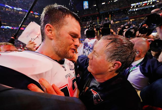 <p>Tom Brady #12 of the New England Patriots talks to head coach Bill Belichick of the New England Patriots after the Patriots defeat the Rams 13-3 during Super Bowl LIII at Mercedes-Benz Stadium on February 3, 2019 in Atlanta, Georgia. (Photo by Kevin C. Cox/Getty Images) </p>