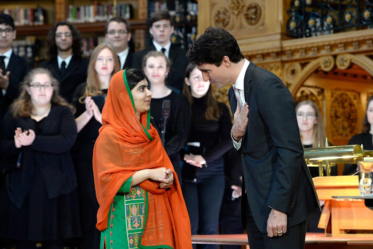<p>Pakistani activist and Nobel Peace Prize winner Malala Yousafzai, left, is presented with an honorary Canadian citizenship by Prime Minister Justin Trudeau in on Parliament Hill in Ottawa on Wednesday, April 12, 2017. (Justin Tang/The Canadian Press via AP) </p>