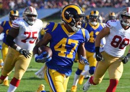Dec 31, 2017; Los Angeles, CA, USA; Los Angeles Rams cornerback Kevin Peterson (47) intercepts a ball intended for San Francisco 49ers wide receiver Marquise Goodwin (11) and runs it back to the 22 yard line in the first half of the game at the Los Angeles Memorial Coliseum. Mandatory Credit: Jayne Kamin-Oncea-USA TODAY Sports