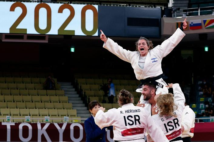 <p>Israel celebrates winning the judo mixed team's bronze medal against Russia.</p>