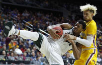 <p>Michigan State forward Xavier Tillman grabs a rebound in front of Minnesota forward Jarvis Omersa, right, during a second round men's college basketball game in the NCAA Tournament, Saturday, March 23, 2019, in Des Moines, Iowa. (AP Photo/Charlie Neibergall) </p>