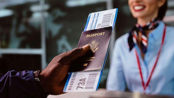 PHOTO: In this undated file photo, a man holds a boarding pass and a passport at an airline check-in desk. (Getty Images, FILE)