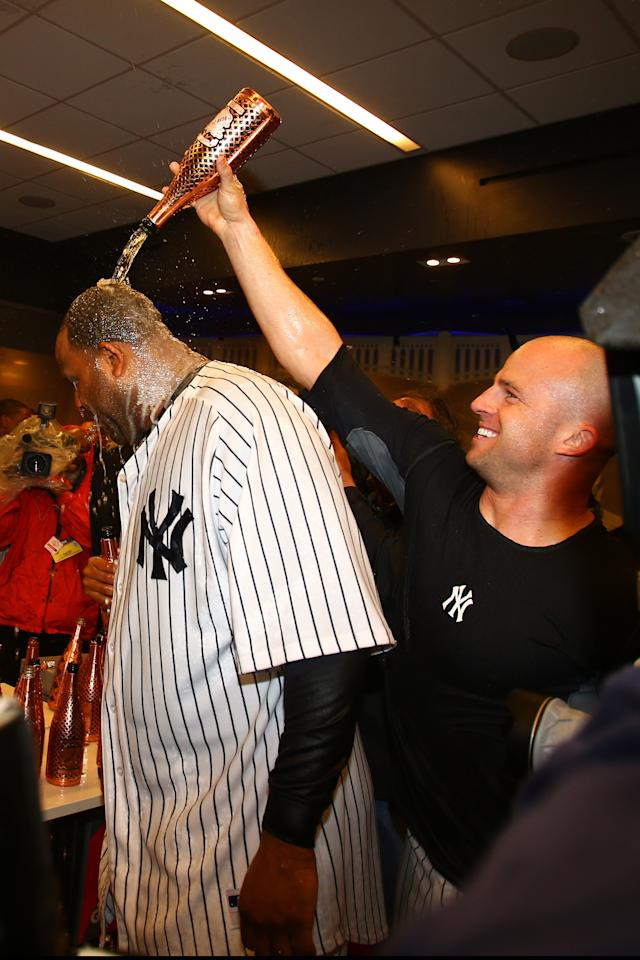 NEW YORK, NY - OCTOBER 12: CC Sabathia #52 and Brett Gardner of the New York Yankees celerbrate in the locker room after defeating the Baltimore Orioles by a score of 3-1 to win Game Five of the American League Division Series at Yankee Stadium on October 12, 2012 in New York, New York.  (Photo by Elsa/Getty Images)
