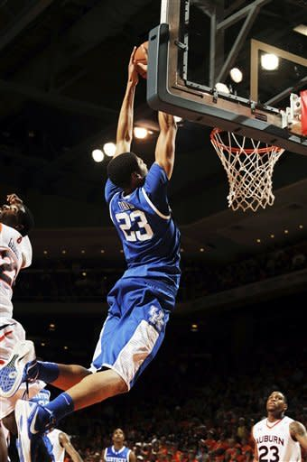 Kentucky's Anthony Davis (23) dunks against Auburn during the second half of their NCAA college basketball game, Wednesday, Jan. 11, 2012, in Auburn, Ala. Kentucky won 68-53. (AP Photo/Todd J. Van Emst)