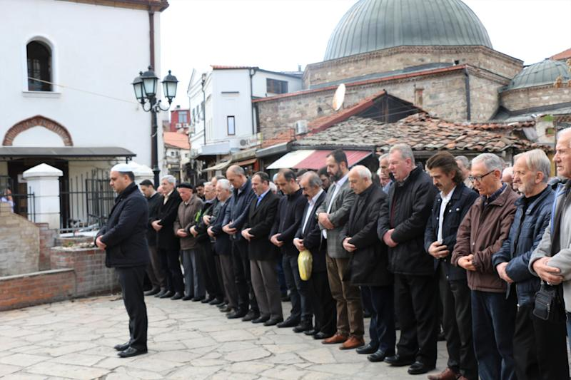 People perform funeral prayer in absentia for those who lost their lives during twin terror attacks in New Zealand mosques in Skopje, North Macedonia.