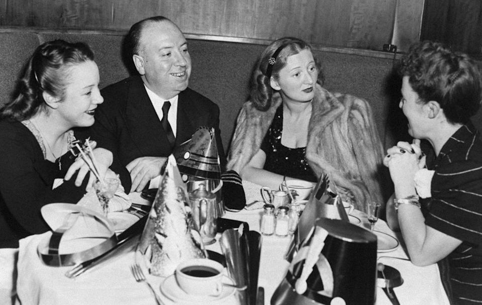<p>Famed Master of Suspense Alfred Hitchcock, director of <em>Psycho</em> and <em>The Birds</em>, rings in the new year with his daughter, Patricia (left), and wife, Alma (right), in New York City's Stork Club, circa 1960.</p>