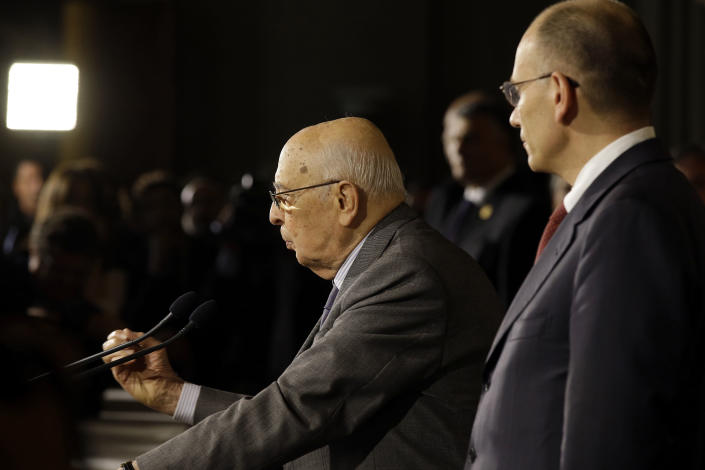 Italian designate-Premier Enrico Letta, right, and Italian President Giorgio Napolitano meet journalists the Quirinale, presidential palace, in Rome, Saturday, April 27, 2013. Italy has finally has a new government, a coalition of Berlusconi's forces and center-left rivals who forged an unusual alliance to break a two-month stalemate following inconclusive elections. Enrico Letta, a center-left leader, will be premier in the government, which marks the latest political comeback by Silvio Berlusconi. (AP Photo/Gregorio Borgia)