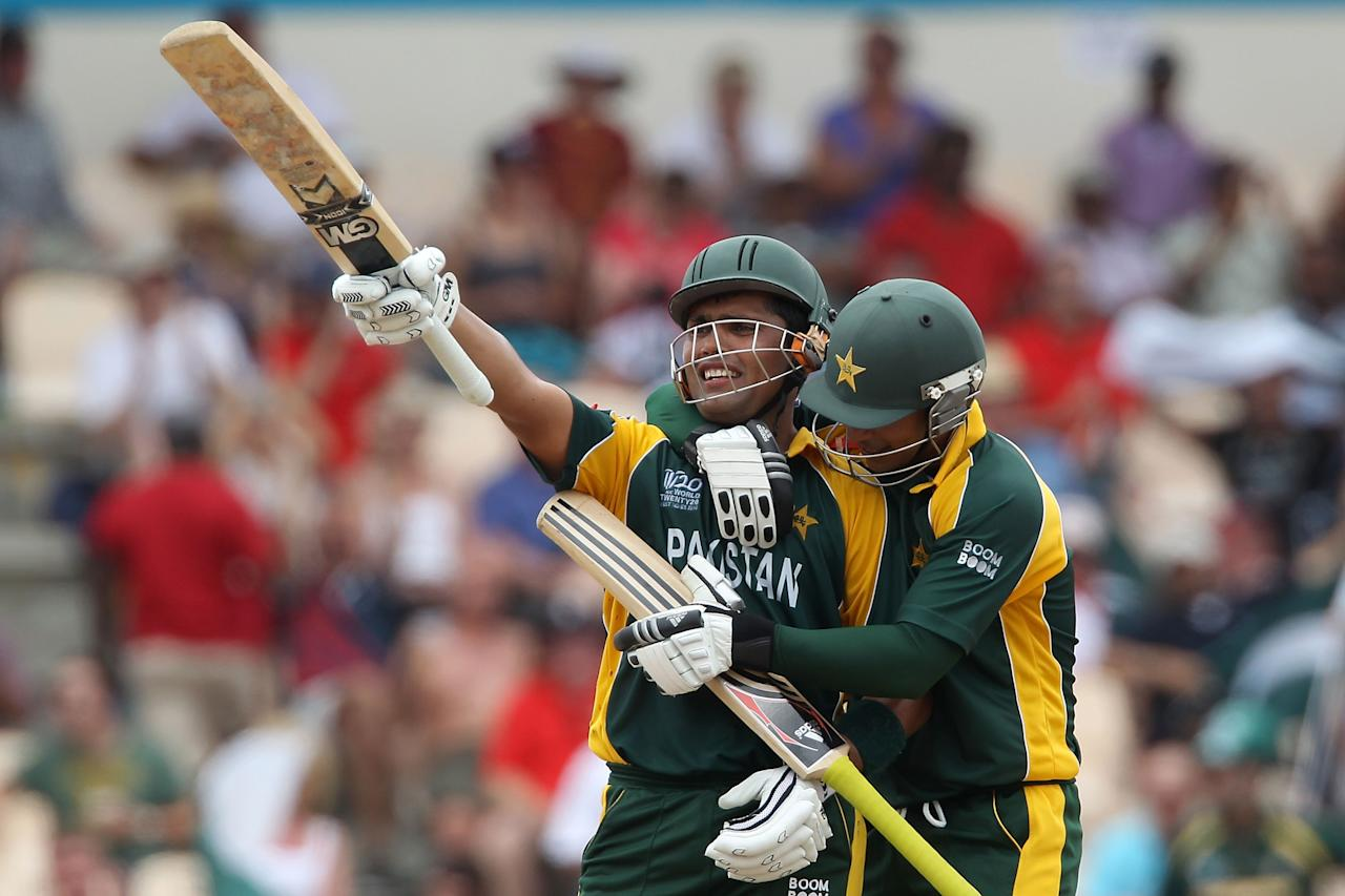 GROS ISLET, SAINT LUCIA - MAY 14:  Kamran Akmal of Pakistan celebrates his half century with Salman Butt during the ICC World Twenty20 semi final between Australia and Pakistan at the Beausjour Cricket Ground on May 14, 2010 in Gros Islet, Saint Lucia.  (Photo by Clive Rose/Getty Images)