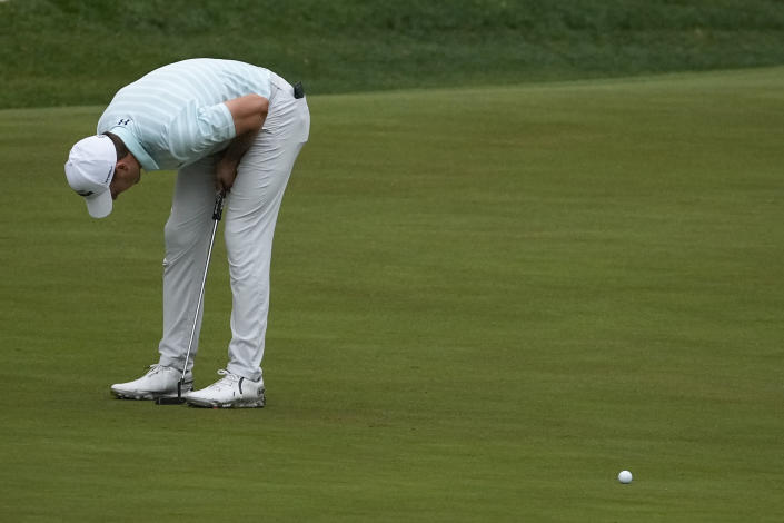 Jordan Spieth reacts to a missed birdie putt on the 13th green during the third round of the Masters golf tournament on Saturday, April 10, 2021, in Augusta, Ga. (AP Photo/Charlie Riedel)
