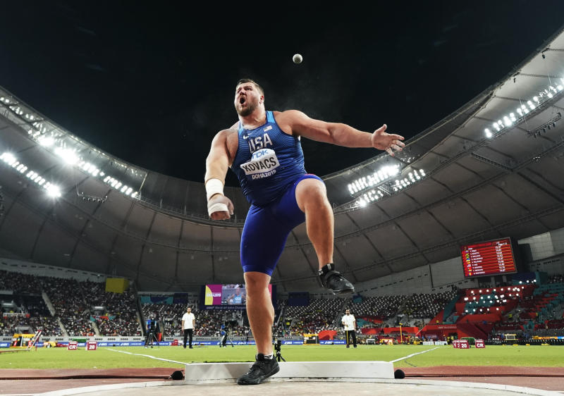 Joe Kovacs, of the United States, competes in the men's shot put final to win the championship record for gold at the World Athletics Championships in Doha, Qatar, Saturday, Oct. 5, 2019. (AP Photo/David J. Phillip)