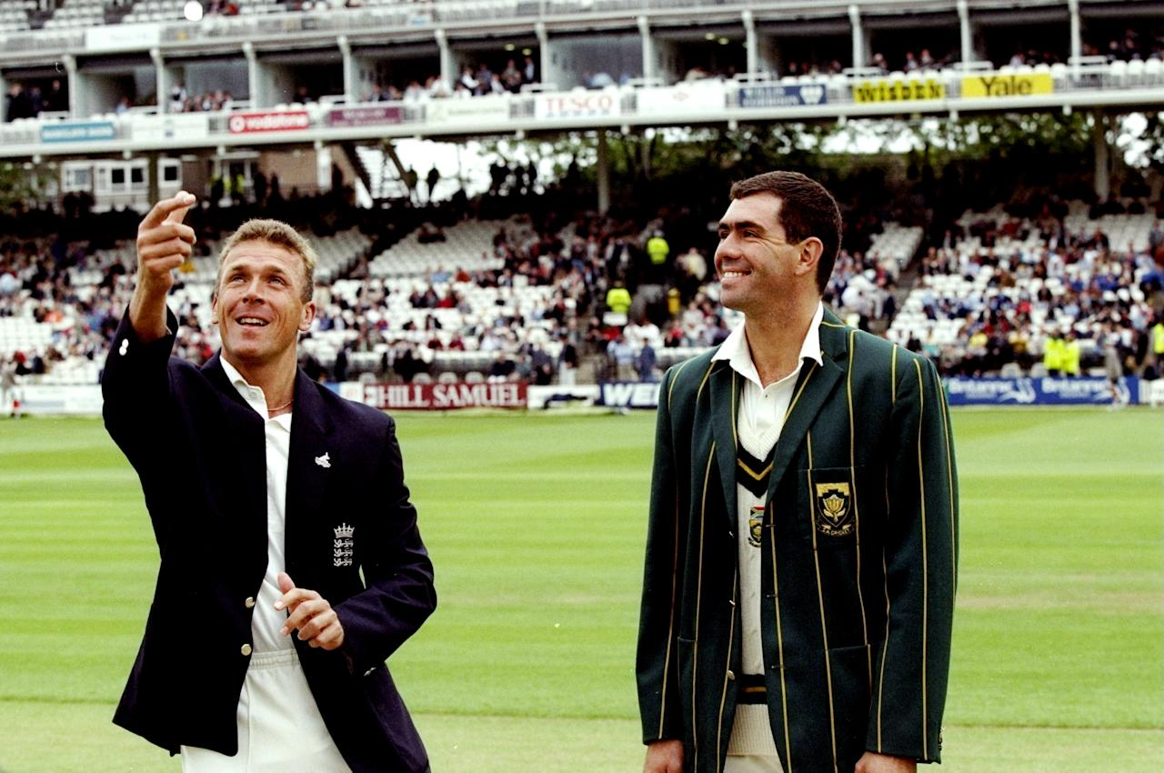 21 Jun 1998:  Captains Alec Stewart (left) of England and Hansie Cronje of South Africa toss up before the Second Test match at Lord's in London. South Africa won the match by ten wickets. \ Mandatory Credit: Clive  Mason/Allsport