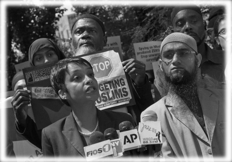 Hina Shamsi, left, director of the ACLU's National Security Project, addresses the media on a plaza in front of New York City Police Department headquarters in 2013. (Photo: Richard Drew/AP; digitally enhanced by Yahoo News)