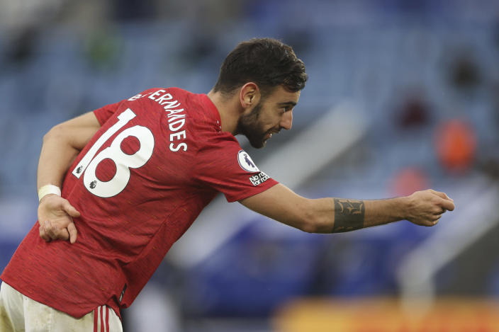 Manchester United's Bruno Fernandes celebrates after scoring his side's second goal during the English Premier League soccer match between Leicester City and Manchester United at the King Power Stadium in Leicester, England, Saturday, Dec. 26, 2020. (Carl Recine/Pool via AP)
